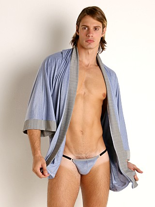 Model in sky blue Gregg Homme Breeze Robe/String Ensemble