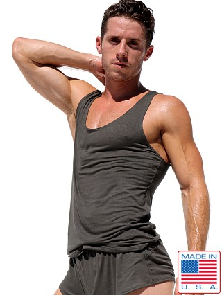 Model in dark army Rufskin Summit Stretch Rayon Tank Top