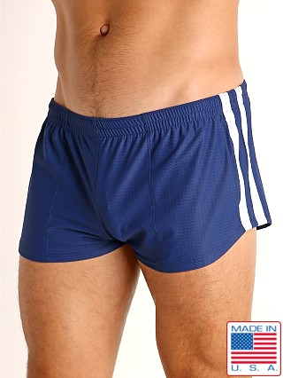 Model in navy/white LASC Performance Mesh Running Shorts