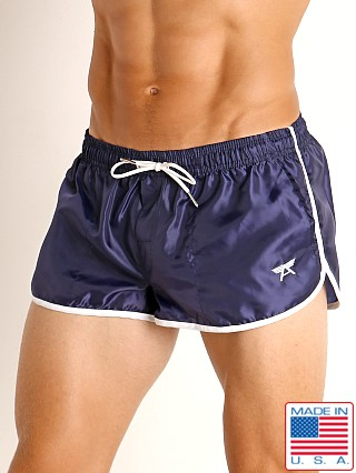 Model in navy LASC Nylon Running Shorts