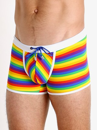 Model in rainbow stripes TOF Paris Pride Enhancing Swim Trunks