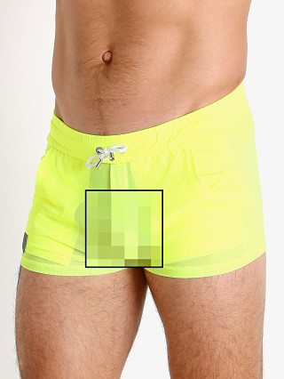 Model in yellow TOF Paris Happy Neon Sheer Mesh Shorts