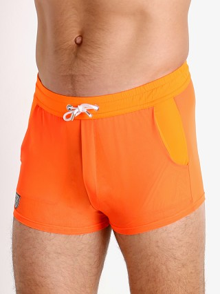 Model in orange TOF Paris Happy Neon Sheer Mesh Shorts