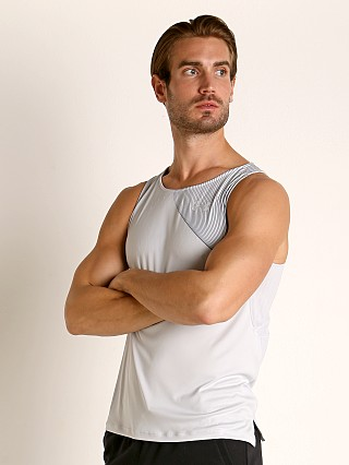 Model in halo gray/reflective Under Armour Qualifier Iso-Chill Runner's Tank Top Halo Gray