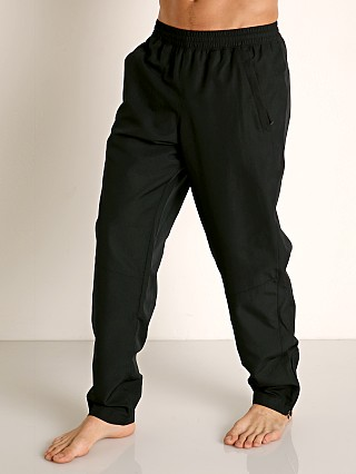 Model in black Under Armour Sportstyle Woven Pant