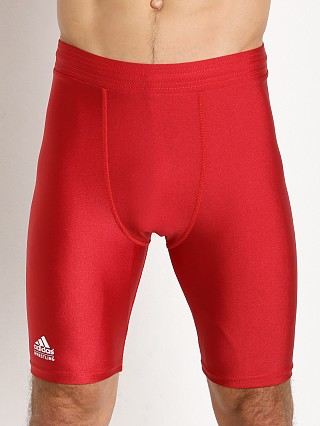 Model in red Adidas Wrestling Compression Short
