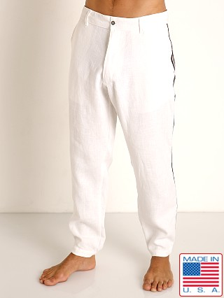 Model in white Sauvage Linen Resort Pants