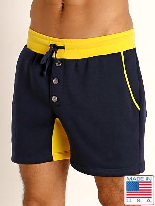 Model in navy/gold LASC Fleece Colorblock Drawstring Shorts