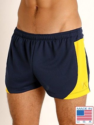 Model in navy/gold LASC Pique Mesh Lined Running Shorts