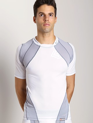 Model in white Shock Doctor Velocity Motion 360 Short Sleeve Shirt