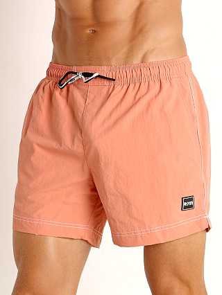 Model in coral Hugo Boss Tuna Swim Shorts