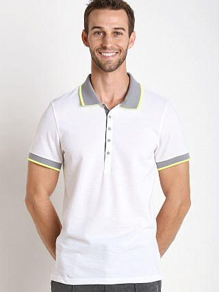 Model in white 2xist Modern Sport Tipped Polo Shirt
