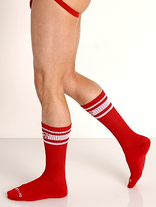 Model in red Nasty Pig Hook'd Up Sport Socks