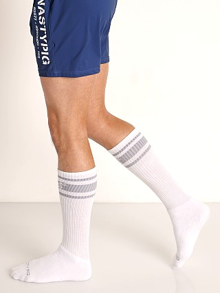 Model in white Nasty Pig Hook'd Up Sport Socks