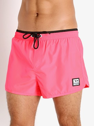 Model in neon pink Diesel Reef-30 Swim Shorts