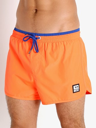 Model in neon orange Diesel Reef-30 Swim Shorts