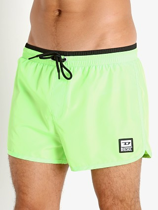 Model in neon green Diesel Reef-30 Swim Shorts