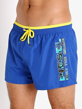 Model in blue Diesel Sandy Swim Shorts