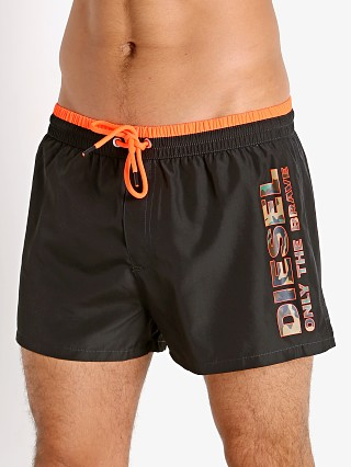 Model in black Diesel Sandy Swim Shorts