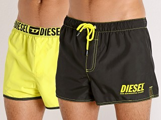 Model in black/yellow Diesel Sandy Reversible Swim Shorts