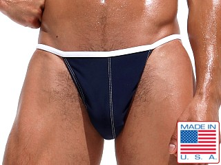 Model in navy Rufskin Sergio Euro-Cut Swim Briefs