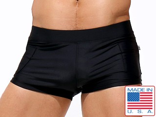 Model in black Rufskin Zeca Square-Cut Swim Trunks