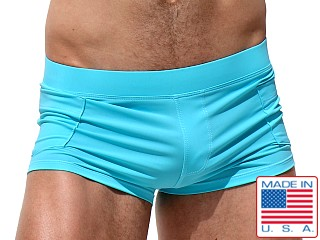 Model in turquoise Rufskin Zeca Square-Cut Swim Trunks