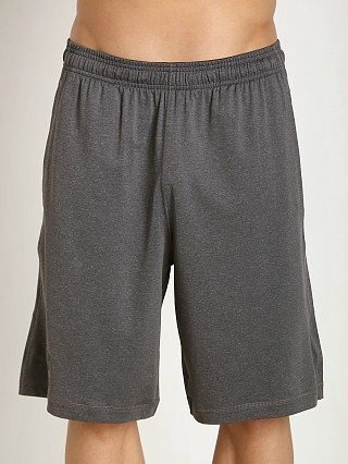 "Model in carbon heather Under Armour 10"" Pocketed Raid Short"