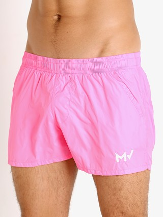 Model in fuchsia Modus Vivendi Corn Pique Swim Shorts