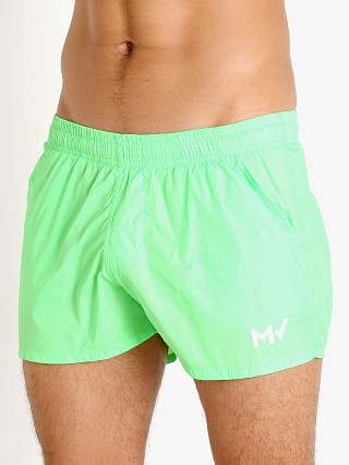 Model in neon green Modus Vivendi Corn Pique Swim Shorts