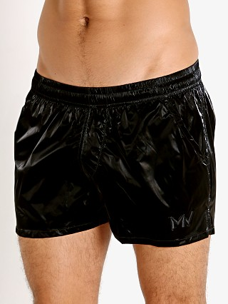 Model in metallic black Modus Vivendi Monochrome Swim Shorts