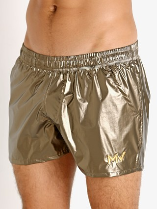 Model in khaki gold Modus Vivendi Monochrome Swim Shorts