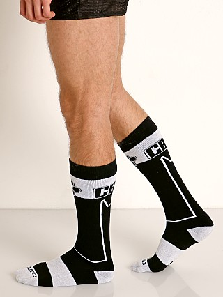 Model in white Cell Block 13 Kennel Club Alpha Knee Socks