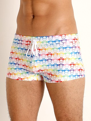 Model in flamingo rainbow 2xist Pride Cabo Sliq Swim Trunk