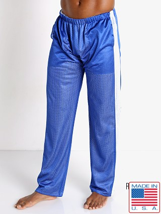 Model in royal/white LASC Reversible Athletic Mesh Pants