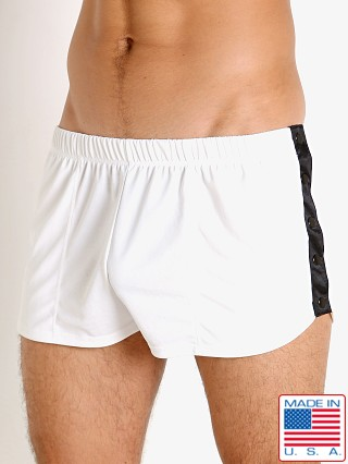 Model in white LASC Matte Jersey Snap Shorts