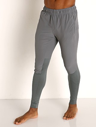 Model in pitch gray/black Under Armour Hybrid Pant Leggings