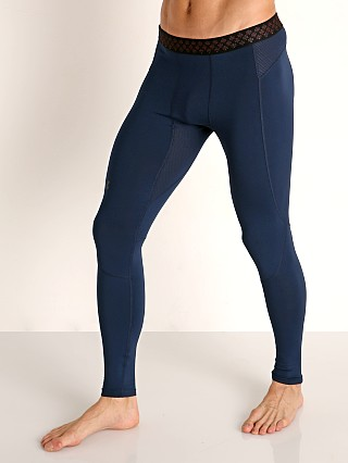 Model in academy/black Under Armour Rush Heat Gear Leggings
