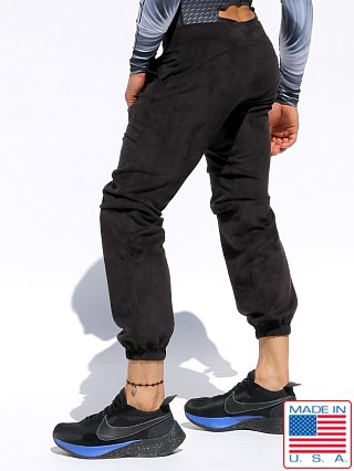 Model in black Rufskin Practice Ultra Suede Track Pants