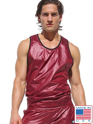Model in burgundy Rufskin Rev Wet Look Reversible to Mesh Tank Top