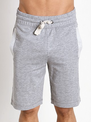 Model in light grey heather 2xist Active Core Terry Short