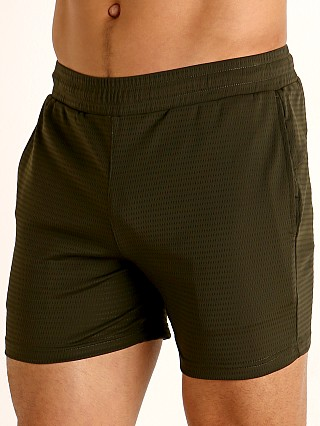 Model in olive St33le Stretch Mesh Performance Shorts