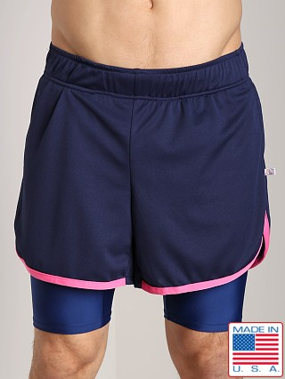 Model in navy/neon pink American Jock Competition Workout Short