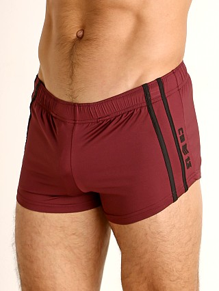 Model in burgundy Cell Block 13 Cyclone 2.0 Short