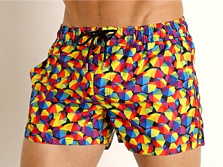 Model in beach umbrella rainbow 2xist Pride Ibiza Swim Shorts