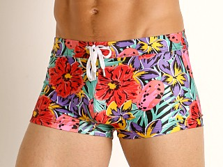 Model in jungle floral 2xist Fashion Sliq Cabo Swim Trunk