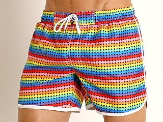 Model in retro geo 2xist Pride Jogger Ibiza Swim Shorts