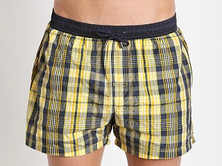 Model in yellow/navy Hugo Boss Catshark Swim Shorts