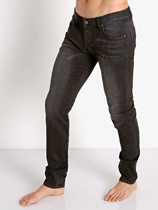 Model in black Nasty Pig Jeans