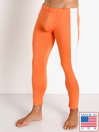 Model in tangerine Go Softwear Body 2 Extreme Tights